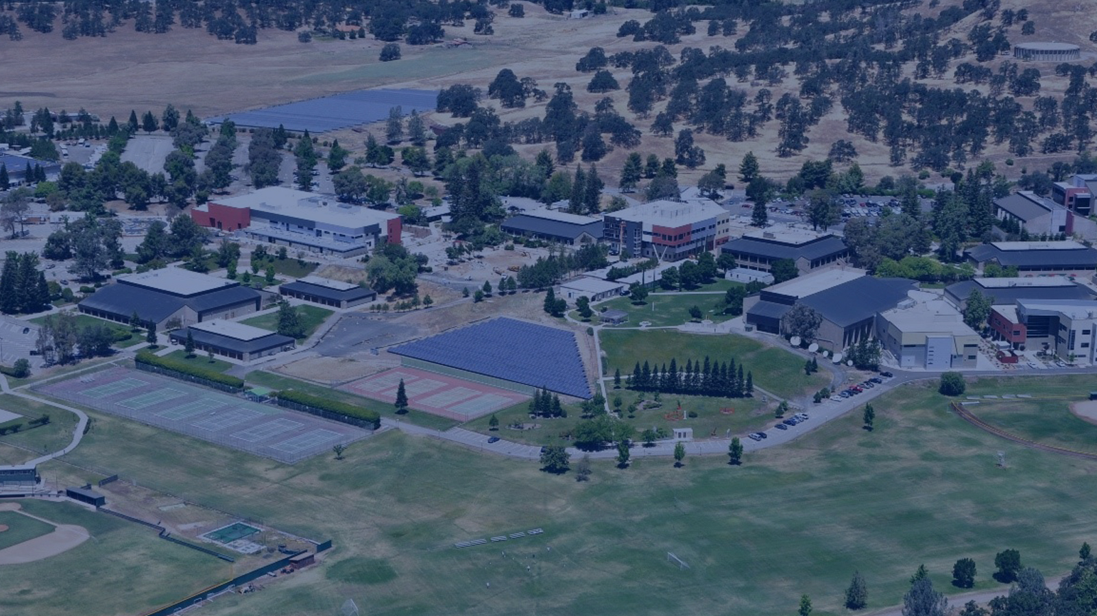 """<h4>Butte College, California</h4> <h5>In 2011, Butte College became the nation's first college campus to become """"grid positive,"""" meaning that the college generated more electricity than it used, thanks to 25,000 solar panels installed since 2005. <a href=""""#one""""><u>Learn more.</u></a> </h5> <em>Butte College</em>"""